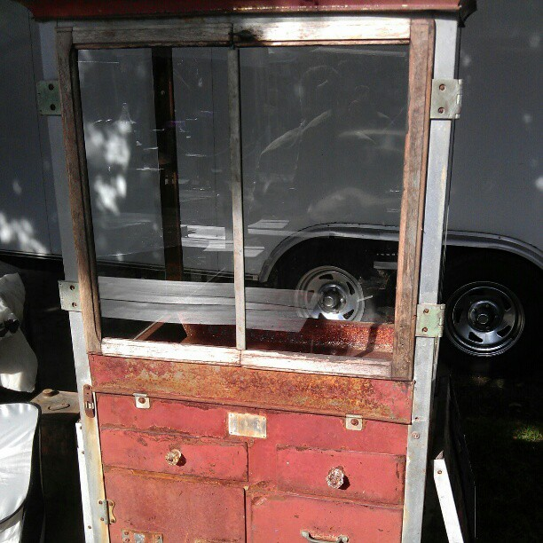Before...1920' popcorn machine....now...glass cabinet...by Melrose Ticket booth G3