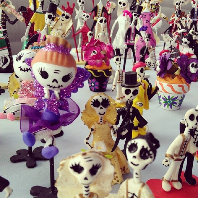The vendor in M19 has these gorgeous handmade Day of the Dead figurines!