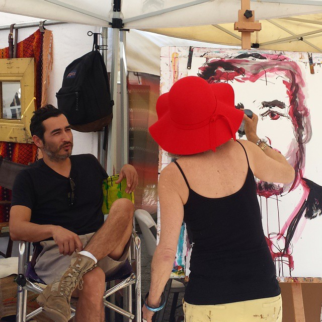 Artist @JulieArnoff is painting her neighboring vendor, Miguel. What a talent! #MTPfairfax #LAartist